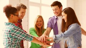 Students in school showing unity with their hands together. Education and school - students showing unity with their hands together stock footage
