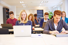Students in school working stock photography