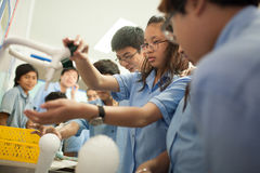 Students in science class, studying the reaction of dry ice Stock Photography