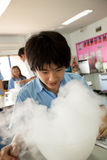 Students in science class, studying the reaction of dry ice Stock Image