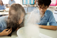 Students in science class, studying the reaction of dry ice Stock Images
