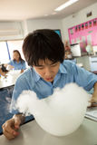 Students in science class, studying the reaction of dry ice Stock Photo