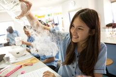 Students in science class, studying the reaction of dry ice Royalty Free Stock Photography