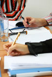 Students on the seminar #4. Business seminar situation, students with papers and pens in hands Royalty Free Stock Photography