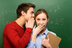 Students sharing secrets Royalty Free Stock Image