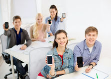 Students showing black blank smartphone screens Stock Image