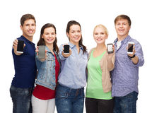 Students showing blank smartphones screens. Education and modern technology concept - smiling students showing blank smartphones screens Stock Photography
