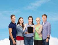 Students showing blank tablet pc screen Royalty Free Stock Image