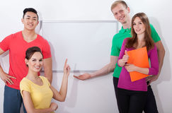Students showing empty whiteboard Royalty Free Stock Photo