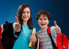 Students showing Ok sign. Students showing thumb up sign Royalty Free Stock Image