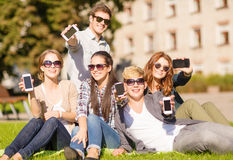 Students showing smartphones Stock Photos