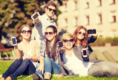 Students showing smartphones Stock Photography