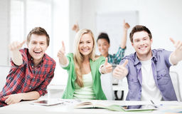 Students showing thumbs up at school Stock Photo