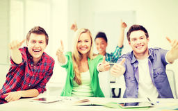 Students showing thumbs up at school Royalty Free Stock Photography