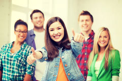 Students showing thumbs up at school Stock Photos