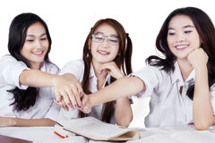 Students showing unity with their hands Stock Photos