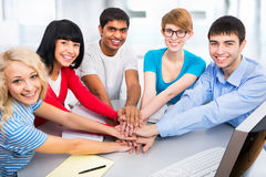 Students showing unity with their hands together Royalty Free Stock Images