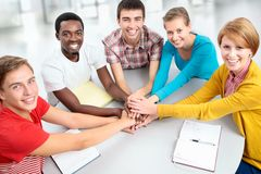 Students showing unity with their hands together Royalty Free Stock Photo