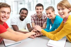 Students showing unity with their hands together Stock Photos
