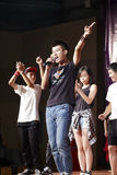 Students singing and dancing. Xiamen nanyang university held concert to commemorate the 65th anniversary of the founding of china and the chenjiageng-birthday royalty free stock photography