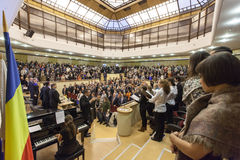 Students singing Gaudeamus. Young students attend the opening of the academic year royalty free stock images