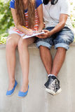 Students sitting with book. Portrait of young couple outdoors Royalty Free Stock Photography