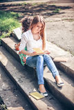 Students sitting with a books. On street Stock Photography