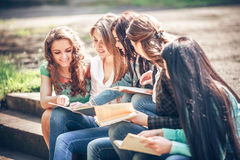 Students sitting with a books on street Stock Image