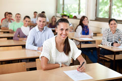 Students sitting at the classroom stock photography