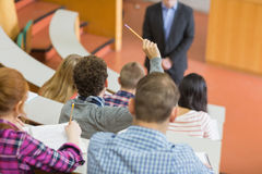 Students sitting at the college lecture hall Royalty Free Stock Photo