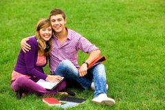 Students sitting on grass Royalty Free Stock Photography