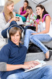 Students sitting on high-school stairs in break. Music reading teens Stock Image