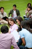 Students sitting outdoors Stock Photography