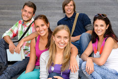 Students sitting on school stairs smiling teens. Campus college friends Stock Photography