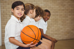 Students sitting on a sports bench. At the elementary school Royalty Free Stock Image