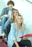 Students sitting on the steps Stock Image