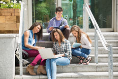 Students sitting on steps studying Royalty Free Stock Images