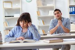 The students sitting and studying in classroom college. Students sitting and studying in classroom college Royalty Free Stock Image