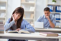 The students sitting and studying in classroom college. Students sitting and studying in classroom college Royalty Free Stock Photo