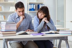 The students sitting and studying in classroom college. Students sitting and studying in classroom college Royalty Free Stock Photos