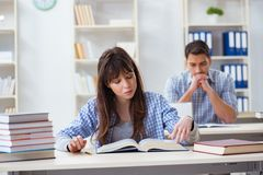 The students sitting and studying in classroom college. Students sitting and studying in classroom college Stock Images