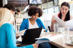 Students sitting at the table and study Stock Image