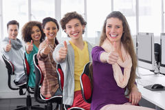 Students smiling at camera in computer class Stock Photography