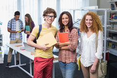 Students smiling at camera standing in a line. At the college Royalty Free Stock Images