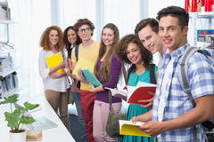 Students smiling at camera standing in a line Stock Image