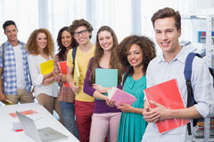 Students smiling at camera standing in a line. At the college Royalty Free Stock Photography