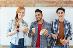 Students with snack Royalty Free Stock Photo
