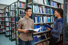 Students speaking in library Stock Photos