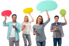 Students with speech bubbles and gadgets stock images