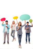Students with speech bubbles and gadgets Royalty Free Stock Image
